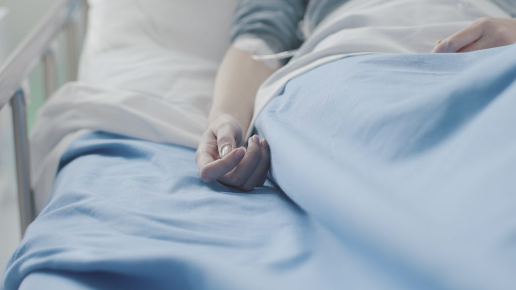 Woman in a bed requiring end of life care